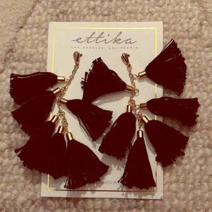 Black and gold tassel earrings from Ettika